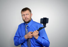 Bearded Businessman making selfie with a stick Stock Photo