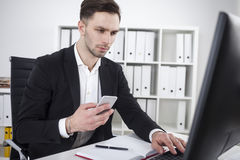 Bearded businessman with phone typing Royalty Free Stock Photo