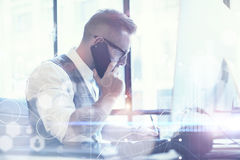 Bearded Businessman Planning Global Strategy Virtual Screen.Startup Concept Innovation Graphs Interfaces Icon.Young Man Royalty Free Stock Image