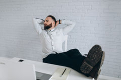 office relaxation. Bearded Businessman Sitting At Desk In Office And Relaxation Royalty Free Stock Photos H