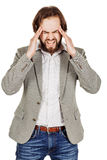 Bearded businessman standing with headache. human emotion expre. Portrait of bearded businessman standing with headache. human emotion expression and office stock image