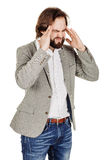 Bearded businessman standing with headache. human emotion expre. Portrait of bearded businessman standing with headache. human emotion expression and office royalty free stock image