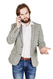 Bearded businessman talking on cell phone.  human emotion expres Stock Image