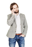 Bearded businessman talking on cell phone.  human emotion expres Royalty Free Stock Image