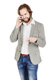 Bearded businessman talking on cell phone.  human emotion expres Stock Photo