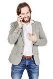 Bearded businessman talking on cell phone.  human emotion expres Royalty Free Stock Photo