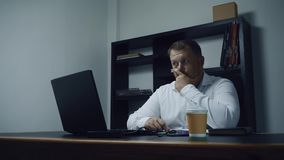 Bearded businessman working in the office on the computer, male surprised and shocked, slow motion stock footage