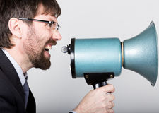 Bearded businessman yelling through bullhorn. Public Relations. man expresses various emotions. photos of young Stock Photos