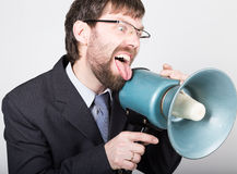 Bearded businessman yelling through bullhorn. Public Relations. man expresses various emotions. photos of young Stock Image