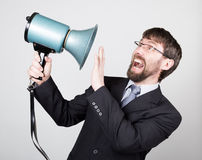 Bearded businessman yelling through bullhorn. Public Relations. man expresses various emotions. photos of young. Businessman wearing a suit and tie Stock Image