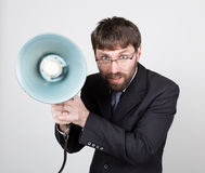 Bearded businessman yelling through bullhorn. Public Relations. man expresses various emotions. photos of young. Businessman wearing a suit and tie Stock Photography