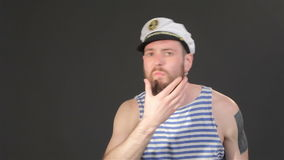 Bearded captain tidies himself stock video