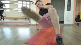 Bearded caucasian fat man engaged in a fitness center by the method of tabata, slow motion. Fitness club stock footage