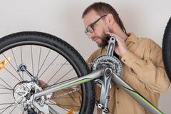 Bearded caucasian man repairing  the mtb bicycle Royalty Free Stock Photo