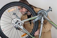 Bearded caucasian man repairing  the mtb bicycle Royalty Free Stock Images