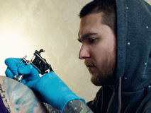 Bearded Caucasian tattooist Stock Image