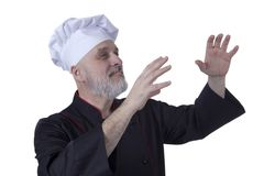 Bearded chef with arms raised Royalty Free Stock Image