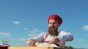 Bearded chef cooking on fresh air. Baker baking bread . Baker kneading the dough. Baker with a variety of healthy and. Delicious freshly baked bread and pastry stock footage