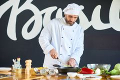Bearded Chef Cutting Eggplant stock image