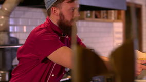 The bearded chef gives an order of a young waitress. stock video