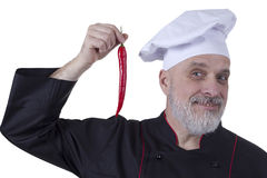 Bearded Chef holding hot chilli peppers Royalty Free Stock Photos