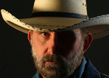 A Bearded Cowboy with His Face in Shadow Royalty Free Stock Photography