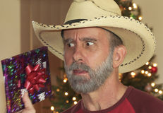 A Bearded Cowboy Tries to Guess His Christmas Present Stock Images
