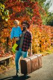 Bearded dad telling son about travelling. Traveler with lot experience. Spirit of adventurism. Father with suitcase and. His son. Family time. Adventure with royalty free stock photography
