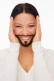 Bearded deaf woman with closed ears Stock Photo