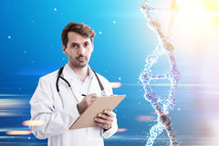 Bearded doctor and a dna. Portrait of a bearded doctor standing against blue background with a dna to his right. Toned image stock image