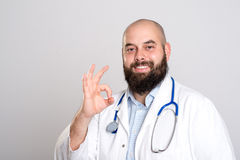 Bearded doctor in white coat- all right Royalty Free Stock Images