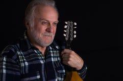 Bearded elderly man with mandolin Stock Photo