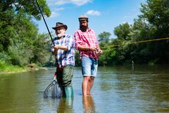 Bearded elegant men. Fisher fishing equipment. Fishing is fun. Man relaxing and fishing by lakeside. Pothunter. Fly fish