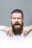Bearded emotional man with paper Stock Photo