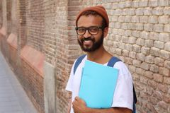Bearded ethnic student holding notebook.  Stock Images