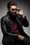 Bearded fashion man fixing his sunglasses Stock Images