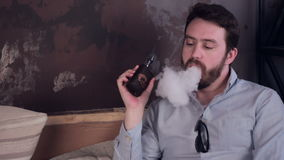Bearded fashion man smoking electronic cigarette. stock video footage