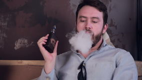 Bearded fashion man smoking electronic cigarette. stock video