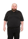 Bearded Fat Man in a Black Shirt Royalty Free Stock Images