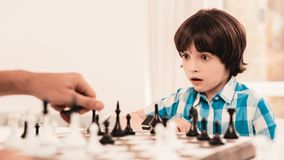 Bearded Father and Son Playing Chess on Table. Happy Family Concept. Board on Table. Young Boy in Shirt. Indoor Joy. Board Games Concept. Modern Hobby Concept stock images