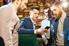 Bearded Friends Having Fun in Pub stock images