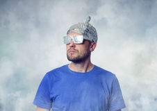Bearded funny man in a cap of aluminum foil. Stock Photography