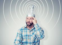 Free Bearded Funny Man In A Cap Of Aluminum Foil Sends Signals. Concept Art Phobias Royalty Free Stock Images - 158637419