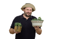 Bearded gardener holding two flower pots. Bearded smiling gardener holding two flower pots Stock Photos