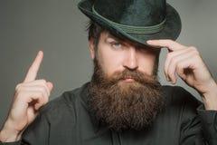 Bearded gentleman in black retro hat Stock Image