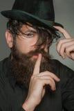 Bearded gentleman in black retro hat Royalty Free Stock Photography