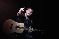 Bearded guitarist pointing fingers on viewer Royalty Free Stock Image