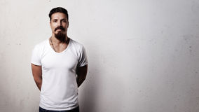 Bearded guy in blank t-shirt Stock Images