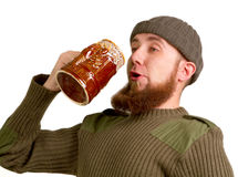 Bearded guy drinking beer from the glass Stock Photos