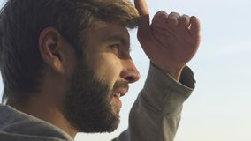 Bearded guy enjoying rising sun view, beauty of nature inspiration and energy. Stock footage stock footage